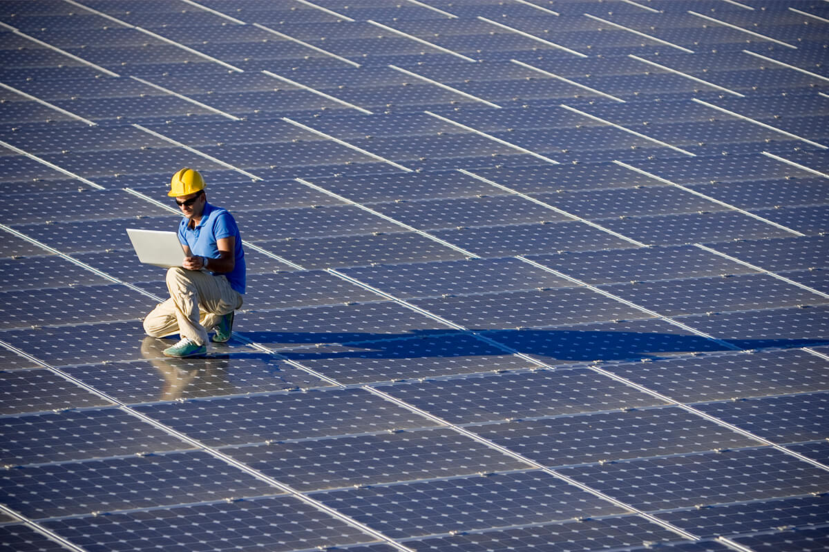 worker-on-solar-panels